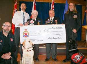 President Lorraine Salkus of Legion Branch #292 Trafalgar/Pro Patria and Angus Stanfield, Chairman of BC/Yukon Legion Foundation with VICD executive director Mike Annan and military Veterans with their PTSD dogs.