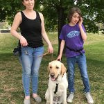 Ryley and his Autism Support Dog, Beau - a yellow Labrador, is with his mother