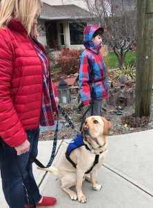 Kye with Autism Service Dog Corky