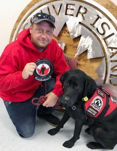 Matt sitting next to PTSD Service Dog Monty