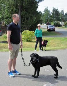 Executive Director of VICD Service Dogs Mike Annan leads training class. Volunteer Dog Boarder with PTSD Service Dog in training Trevor.
