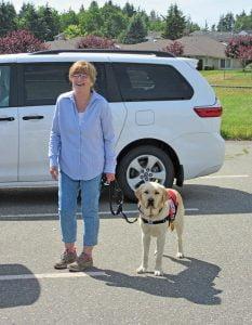 Volunteer Dog Boarder Arlene with PTSD Service Dog in training Jaggar.