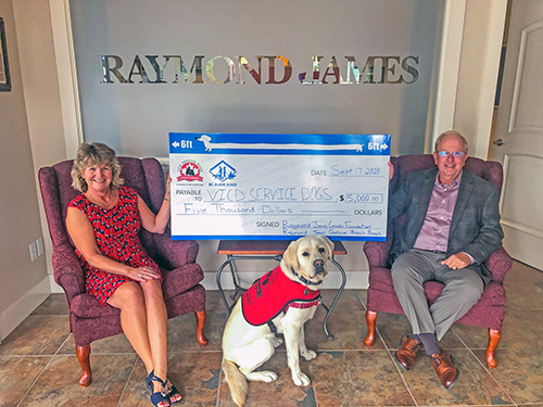 David and Shirley Nellist from Raymond James Qualicum Beach present a $5,000 cheque to VICD Service Dogs